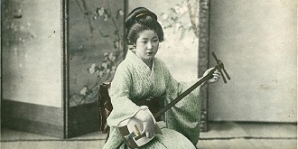Japanese Woman Playing A Shamisen S