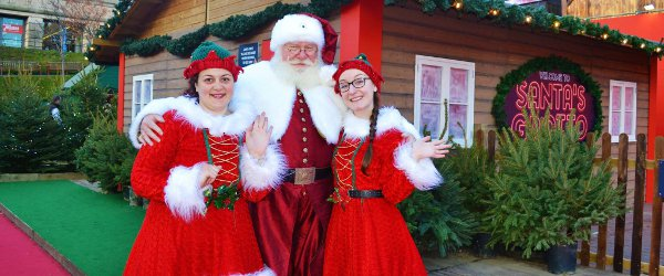 Santa And The Elves At The Grotto 2015